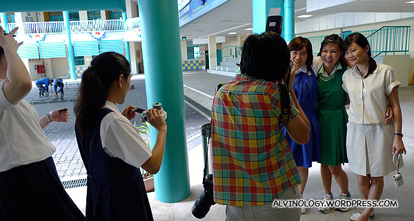 Very old students taking photos