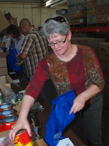 Housing Specialist Leslie Schmidt puts together food packages as part of USDA's Commodity Supplemental Food Program (CSFP).