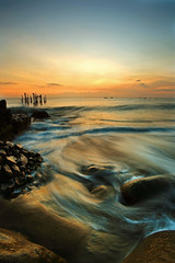 wave suction (Randi Ang) Tags: old longexposure sunset seascape abandoned beach rock canon indonesia landscape harbor jetty wave rush 5d lombok waterscape ntb ef1740mmf4l ampenan westnusatenggara nusatenggarabarat mygearandmepremium mygearandmebronze exharbor