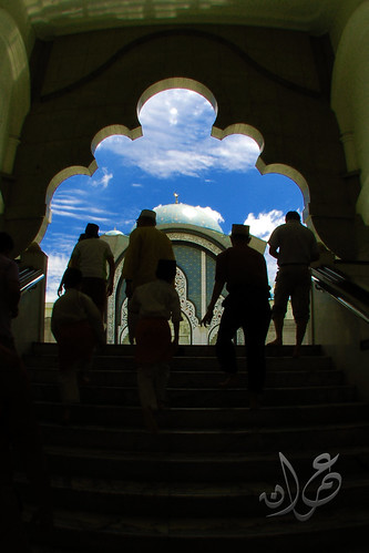 Silhouette of pious muslim entering prayer hall