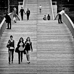 walking on a bridge (fifichat1 - BOYCOTT) Tags: street bridge people blackandwhite bw paris france youth walking women candid streetphotography nb grayscale rue greyscale copyright squarepicture allrightsreserved classicbw formatcarr copyrightallrightsreserved tousdroitsrservs blackwhiteurban nikond300 blackdiamondpremier dragondaggerphoto dragondaggeraward explore4882010august04 asquaresuperstarstemple lightroomps fifichat1