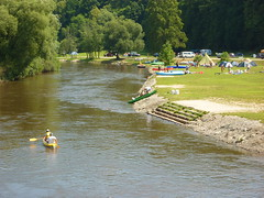 Campsite and canoeists on River Vlatava by Eurapart
