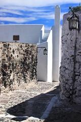 Paved alley (Marite2007) Tags: architecture islands village hellas santorini greece lamps cyclades alleys lanes ellada pyrgos