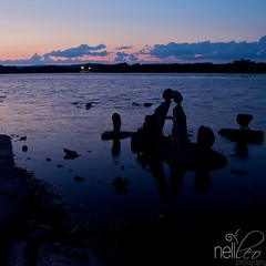 Kissing Stones at Sunset (nellleo) Tags: sunset sky ontario canada art clouds river nikon stones ottawa inukshuk nellleo remikrapids