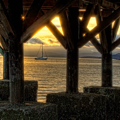 Sailboat Under the Pier