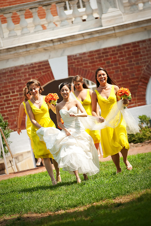 bride and bridesmaids running