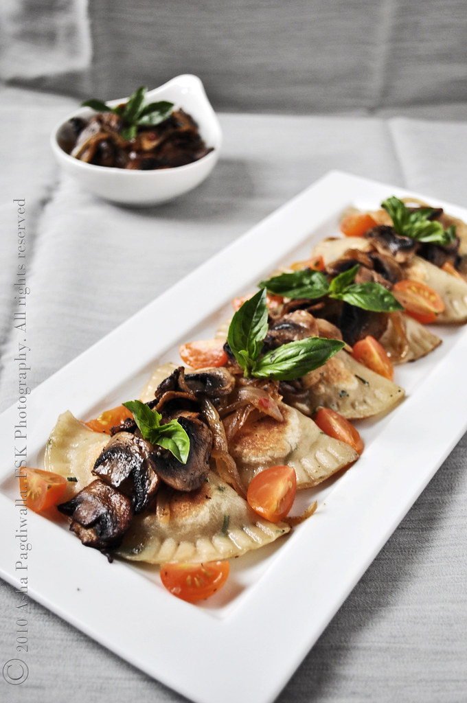 Caramelised Onion, Paneer and Basil Pierogis with Garnish