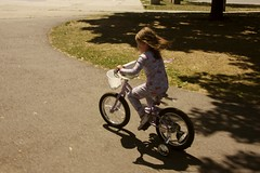 a lovely day for a ride (moominmolly) Tags: girl bike bicycle happy kid ride somerville learning natalie pajamas learn trainingwheels