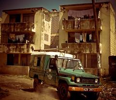 Hrörleg blokk og bíll (Harpa Hrund) Tags: africa cool jeep kenya uncool cool2 cool5 cool3 cool4 uncool2 uncool8 uncool3 uncool5 uncool6 uncool7 uncool9 uncool1 ydkib