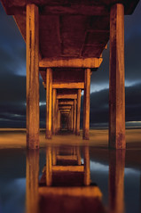 Vertigo (Lee Sie) Tags: ocean california blue red sea orange reflection water night clouds pier pacific sandiego tide lajolla pillars scripps ccl