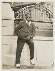Douglas Grant, draughtsman and soldier, with his ornamental pond and Harbour Bridge, Callan Park, between 1932-1940 / photographer Sam Hood