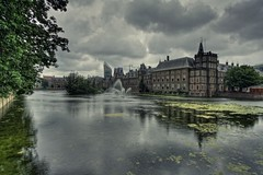 Dark clouds over Dutch parliament (The Wolf) Tags: sky holland reflection water dutch leaves clouds reflections dark pond day cloudy thenetherlands parliament denhaag government buitenhof thehague hdr hofvijver mauritshuis binnenhof torentje regering