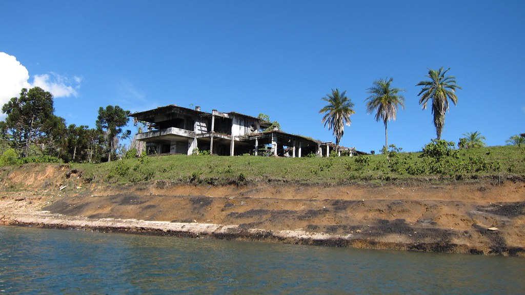 Pablo Escobar's old lake home is now destroyed. We wanted to get off our small motorboat to walk around and take more photos, however the guide said it was private government property and we needed permission. Or, we needed to get there at 7am when nobody was around to see us!
