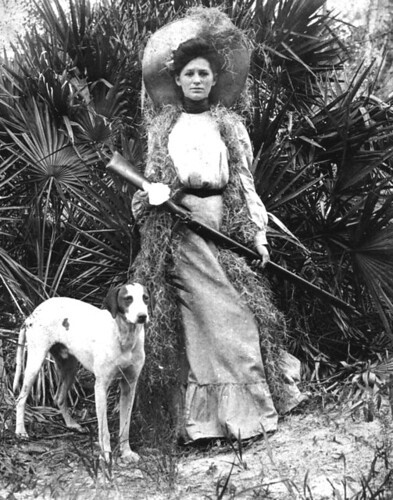 Woman with rifle and dog by State Library and Archives of Florida