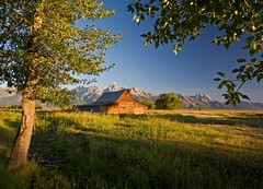 Moulton Barn Sunrise (Matt Champlin) Tags: ranch old morning travel camping trees mountains history sunrise canon landscape rockies dawn peace farm country farming scenic roadtrip western fields wyoming grandtetons peaks tetons majestic moulton grandtetonsnationalpark mormonrow moultonbarn mywinners abigfave eos40d morom wyomingscenic lifeontheranch livingonaranch moultonbarnsunrise moultonbarnscenic