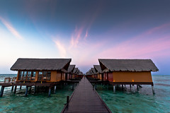 villas on the ocean (flamed) Tags: ocean houses sunset sea vacation sky asia magic country walkway maldives stilts hudhuranfushi oceanvillas adaaranprestige