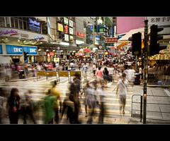Life in Hong Kong - Rush Hour (tamjty) Tags: life china street city longexposure people urban signs blur canon shopping hongkong eos movement asia day snapshot streetphotography documentary lifestyle 7d shops cinematography cinematic mongkok monopod 1585mm