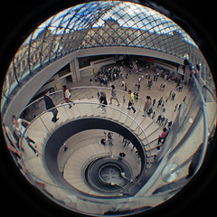 Down to the Louvre (pierofix) Tags: trip people holiday paris france scale museum architecture modern stairs digital canon circle lens fun eos funny lift pyramid louvre digitale wide wideangle august super fisheye persone explore agosto museo francia grandangolo viaggio architettura 45mm vacanza circular spirale divertente cerchio 2010 ascensore parigi piramide palla tonda reducer spyral focale 025x 400d riduttore richarm
