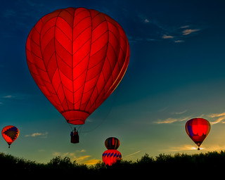 Balloons Ascending at Sunrise