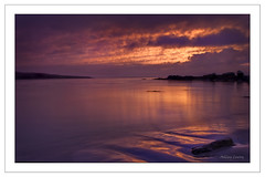 Ballinskelligs Dawn (Ashley Lowry) Tags: morning ireland light red sea sky seascape colour reflection beach water clouds sunrise reflections landscape dawn still sand glow purple kerry sunup ringofkerry iveraghpeninsula ballinskelligs baileansceilg