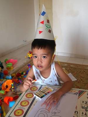 Julian with party hat