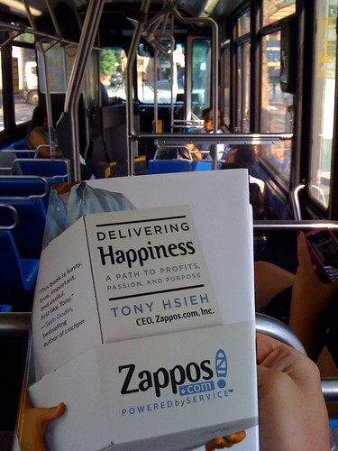 Reading Tony Hsieh's 'Delivering Happiness' on the bus to work - seems fitting right @dhbus?