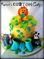 Jungle Baby Shower Cake (Kara's Custom Cakes) Tags: flowers blue elephant leaves yellow teal lion bow zebra greeen babyshower junglecake safaricake