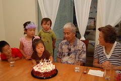 Blowing out candles on Kung Kung's birthday