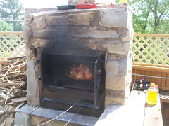 pig in the fire..ady's heart ..cause she is the star (hrdwodwiz) Tags: pig is place 4th july roast adys