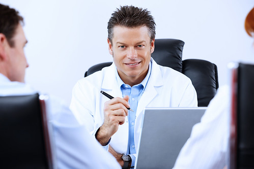 Doctor with Patient and EHR