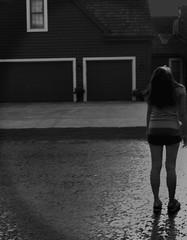 Nicole in the Rain (Bridget Driscoll) Tags: sky people blackandwhite wet rain outside nicole driveway desaturated lightning strom thunder