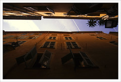 Down a French Alleyway (yumchar_lene) Tags: windows sky france clouds french nice streetlamp palmtrees shutters unusualviewsperspectives