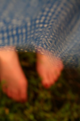 The world keeps spinning, as I stand still. (kristenicole) Tags: longexposure blue white feet grass self chaos bokeh windy blowing polkadots 60mm f28