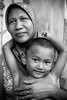 Mother and son (LindsayStark) Tags: travel boy portrait blackandwhite woman children indonesia women asia southeastasia child mother tsunami aceh humanrights humanitarian humanitarianaid waraffected conflictaffected