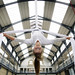 Aerialist Jennifer Paterson from 'Spokes' launches Merchant City Festival at The Briggait suspended on silk 3 Credit - Iain McLean