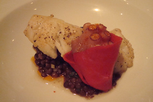 Cod with lentils, blood sausage, and octopus wrapped in pimenton