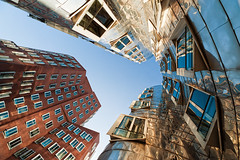 Up (Philipp Klinger Photography) Tags: travel blue windows light sunset shadow sky sun reflection brick window up metal architecture germany frank deutschland nikon angle pov north wide perspective wideangle gehry nrw dusseldorf dsseldorf philipp frankgehry nordrheinwestfalen medienhafen klinger rhinewestphalia d700 dcdead