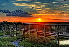 Crabbing Pier Sunset (Ellen Yeates) Tags: ocean park wood blue sunset vacation sky orange cloud sun galveston reflection beach water look grass austin bay pier ellen fishing paint texas tour walk like enjoy ladder freeport hdr surfside yeates stalman ellenyeatesphotography