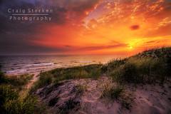 Beach Path at Sunset (Craig - S) Tags: flowers blue orange beach water grass clouds sand waves purple path michigan dune scenic peaceful lakemichigan explore serene wildflowers tranquil ludington imapix ludingtonstatepark ludingtonmichigan