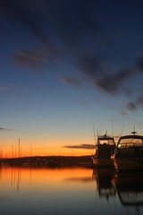 Settled (pominoz) Tags: sunset lake reflection clouds boat valentine nsw lakemacquarie
