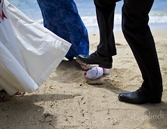mazel tov! (lindilindi) Tags: flowers wedding pakistan love beach glass beautiful ga hawaii groom bride mixed ceremony culture happiness lei hawaiian tradition leis multicultural bengal breaking muumuu kuhio mazeltov modelreleased azeema