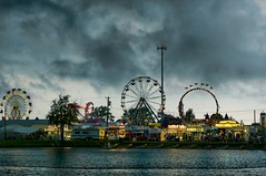 A Night at the Farm Show (cindygraphics) Tags: carnival storm clouds dark pennsylvania butler farmshow amusementrides justclouds