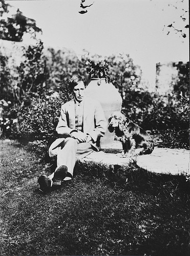 Leonard Woolf and Pinka in Monk's House garden-photograph (modern), 1931