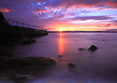 Sunset (Explored) (PeterYoung1) Tags: ocean uk longexposure light sunset sea sun sunlight colour beach water clouds reflections landscape evening pier highlands rocks tramonto sonnenuntergang purple paisaje explore devon paysage landschaft soe  paesaggio 1022 brixham puestadelsol coucherdusoleil the4elements cloudsstormssunsetssunrises