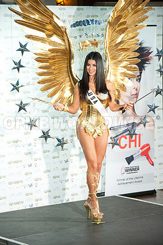 Miss USA 2010 Rima Fakih poses for photographer in her national costume at the Mandalay Bay Resort and Casino in Las Vegas