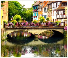 Le pont fleuri-The flowered bridge (jackfre2) Tags: park bridge flowers trees houses france reflections canal colours pillar arches colmar alsace lanterns littlevenice halftimbered lapetitevenise mywinners