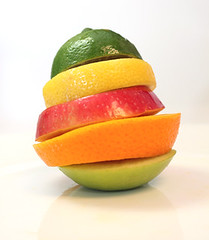 sliced fruit stack (Lori Greig) Tags: morning red summer food orange green colors yellow fruit breakfast colorful bright sweet vivid tasty health balance citrus sour onwhite balanced vitaminc assorted nutrition vitamin nutricious fructose