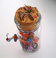 Enchanted Earth Elemental Vintage Juniper Bottle Filled with Found Objects (Enchanticals ~I'm Coming Back) Tags: glass bottle assemblages elementals fairy fantasy enchanticals enchanticalsetsy collectible alteredart enchanted faeteam feather feathers homedecor fairies bead beads handmade collectibles alteredbottle etsy etsyteams assemblage foundobjects earth magical findings blue twig button buttons charm heart heartcharm ornate silver wire driedherbs cork vintage juniper juniperbottle sketch bark shake stamp purple red black foreignstamp sequins