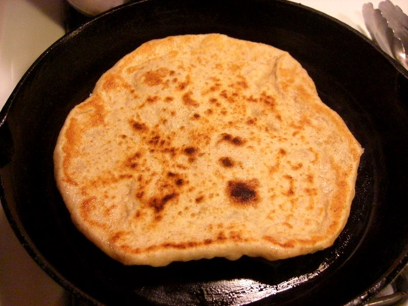 naan in a cast iron pan