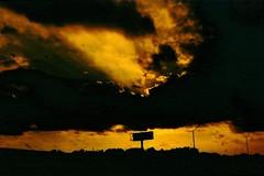 Illuminate (a.li[e]n) Tags: light sunset red sky sun black slr silhouette yellow clouds analog canon evening lomo lomography stream shadows bright ae1 alien annie analogue lin illuminate lightstream redscale sooc redscalexr